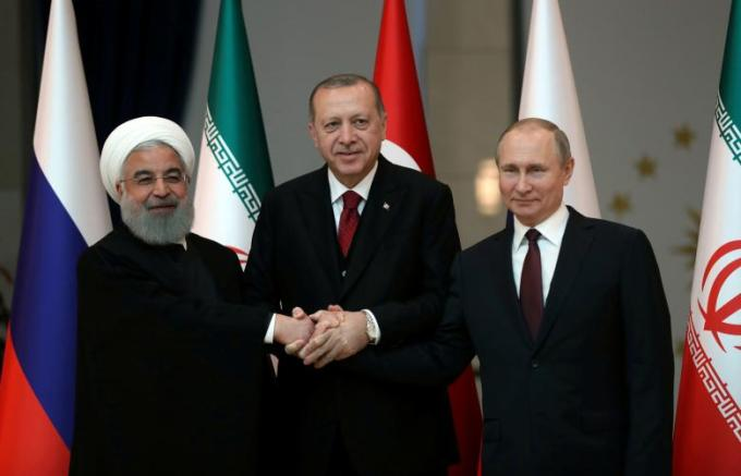 Presidents Rouhani of Iran, Erdogan of Turkey and Putin of Russia pose before their meeting in Ankara